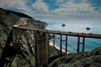 Een onvergetelijke ervaring, met een Harley motor over de Bixby Bridge in Californië.