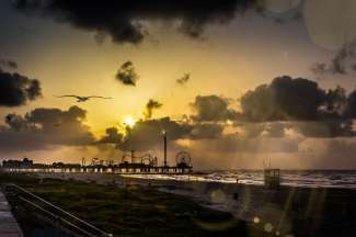 Zonsondergang over de Galveston Pier